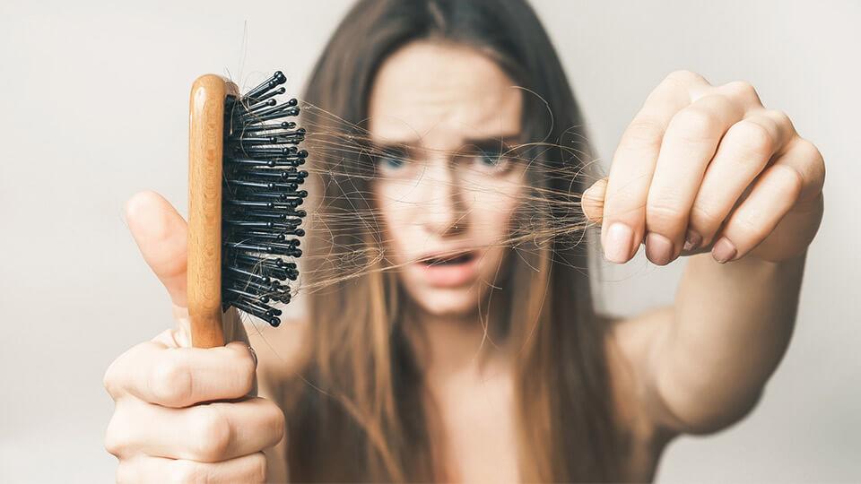 Как остановить выпадение волос - лучшие средства
